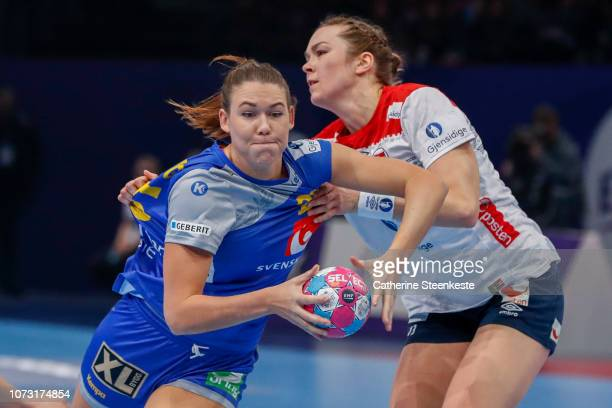 Mikaela Massing of Sweden attempts to shoot the ball against Kari Brattset of Norway during the EHF Euro match for the classification 56 between...