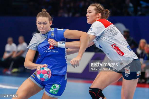 Mikaela Massing of Sweden struggles against Kari Brattset of Norway during the EHF Euro match for the classification 56 between Sweden and Norway at...