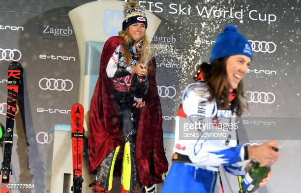 Mikaela Shiffrin celebrates her victory with champagne on the podium of the FIS women World Cup Slalom on Sljeme mountain near Zagreb on January 5,...
