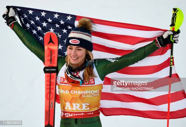 US' Mikaela Shiffrin celebrates with her national flag after winning the women's slalom event at the 2019 FIS Alpine Ski World Championships at the...