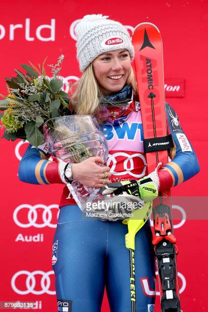 Mikaela Shiffrin of the United States celebrates on the medals podium after winning the Slalom competition during the Audi FIS Ski World Cup...