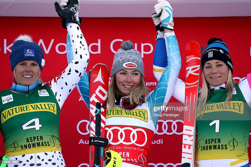 Mikaela Shiffrin (C) of the United States celebrates on the podium after winning the slalom along with Veronika Velez Zuzulova (L) of Slovakia in second place and Frida Hansdotter (R) of Sweden in third place during the Audi FIS Women's Alpine Ski World Cup at the Nature Valley Aspen Winternational on November 28, 2015 in Aspen, Colorado.