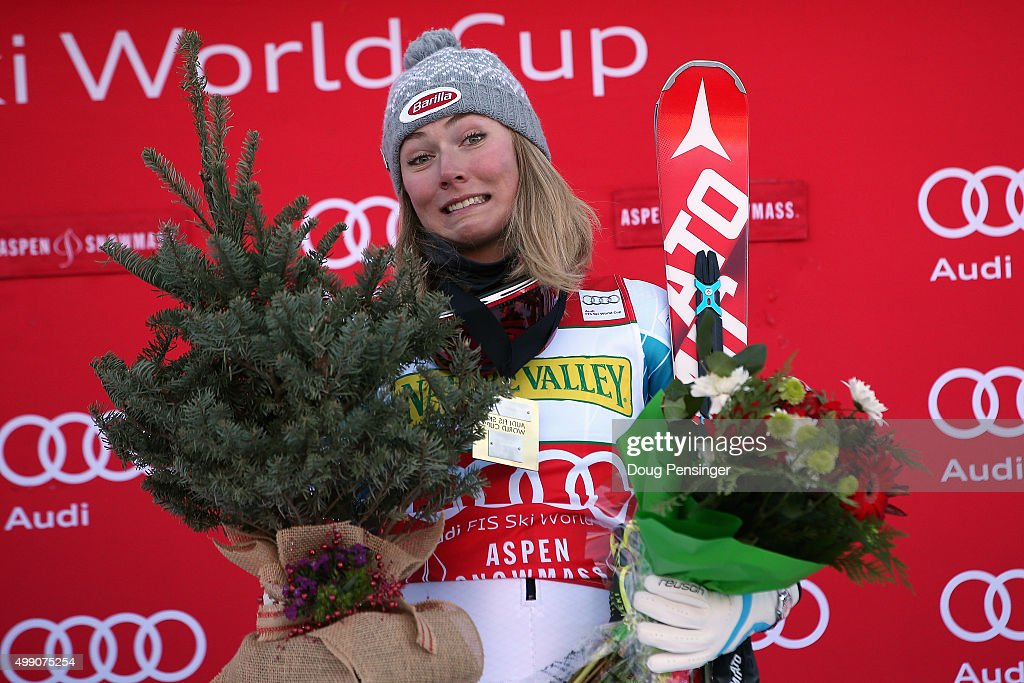 Mikaela Shiffrin of the United States celebrates on the podium with her prizes after winning the slalom during the Audi FIS Women's Alpine Ski World Cup at the Nature Valley Aspen Winternational on November 28, 2015 in Aspen, Colorado.