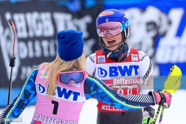 Mikaela Shiffrin of the United States celebrates with Frida Hansdotter of Sweden after winning the Women's Slalom during the Audi FIS Ski World Cup...