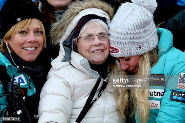 Mikaela Shiffrin of the United States sits with her mother Eileen Shiffrin and grandmother Pauline Condron on the medals podium for a family photo...