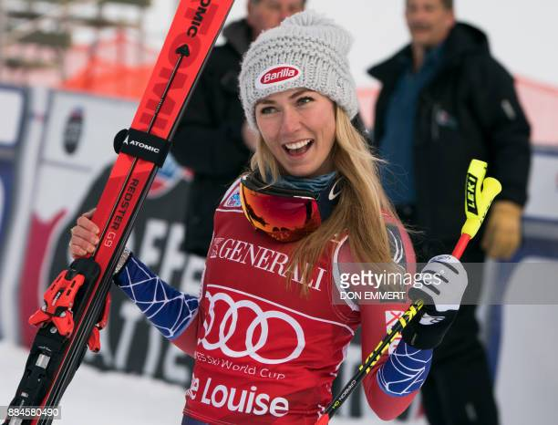 Mikaela Shiffrin of the US celebrates her first place finish during the FIS Ski World Cup Women's Downhill December 2 2017 in Lake Louise Alberta /...