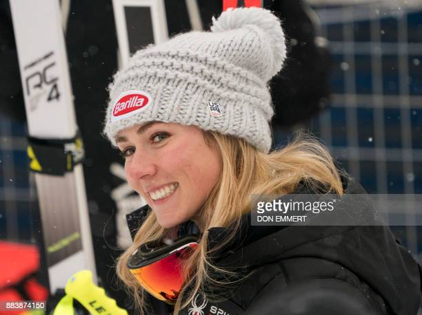 Mikaela Shiffrin of the US smiles to fans after finishing in third place during the FIS Ski World Cup Women's Downhill December 1 2017 in Lake Louise...