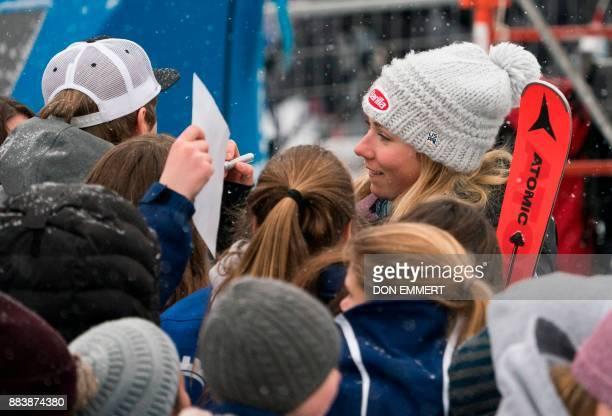 Mikaela Shiffrin of the US smiles while signing autographs after finishing in third place during the FIS Ski World Cup Women's Downhill December 1...