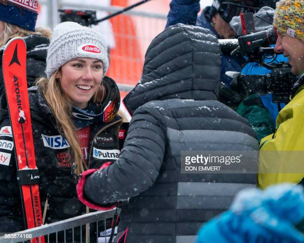 Mikaela Shiffrin of the US smiles while talking to reporters after finishing in third place during the FIS Ski World Cup Women's Downhill December 1...
