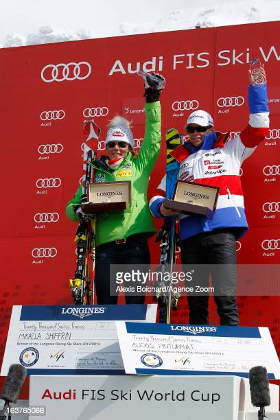 Mikaela Shiffrin of the USA and Alexis Pinturault of France receive the trophy of the best young skier of the season during the Audi FIS Alpine Ski...
