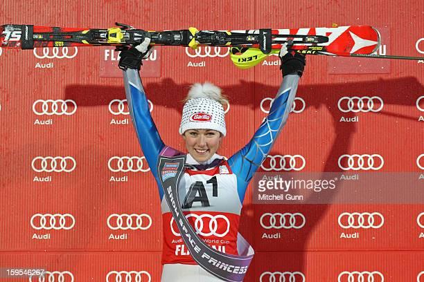 Mikaela Shiffrin of the USA celebrates on the podium after winning the Audi FIS Alpine Ski World Cup Slalom race on January 15 2013 in Flachau Austria