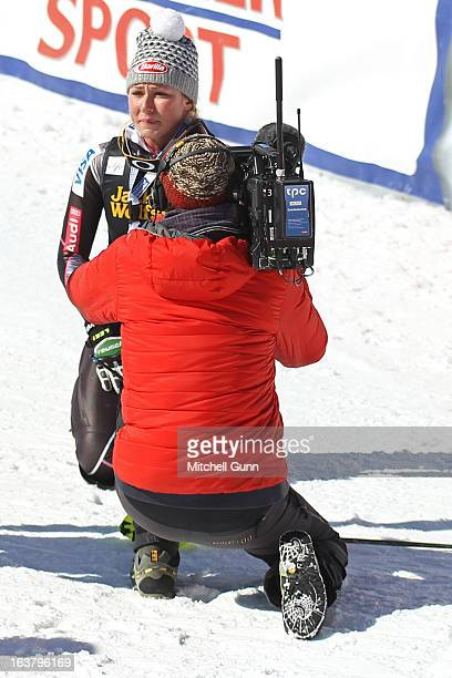 Mikaela Shiffrin of the USA reacts after realising she has won the overall slalom title at the Audi FIS Alpine Skiing World Cup Finals slalom race on...