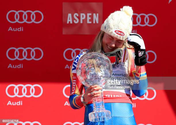 Mikaela Shiffrin of United States celebrates with the globe for being awarded the overall season ladies' champion at the 2017 Audi FIS Ski World Cup...