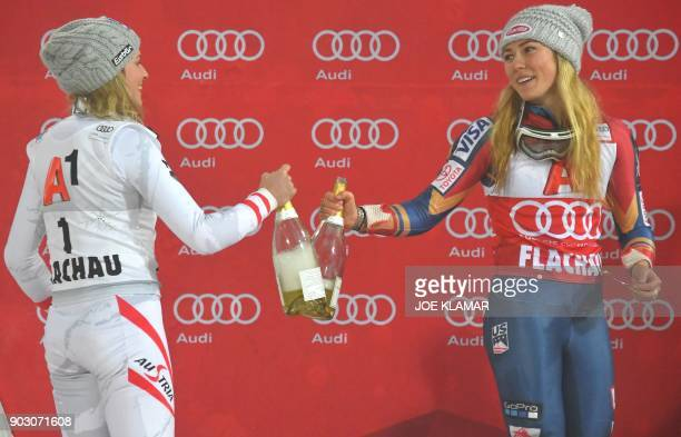 Mikaela Shiffrin of USA and Bernadette Schild of Austria celebrate with champagne on the podium of the FIS World Cup Ladies night Slalom race in...