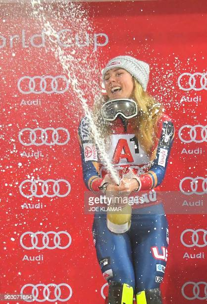 Mikaela Shiffrin of USA celebrates with champagne on the podium of the FIS World Cup Ladies night Slalom race in Flachau Austria on January 9 2018 /...