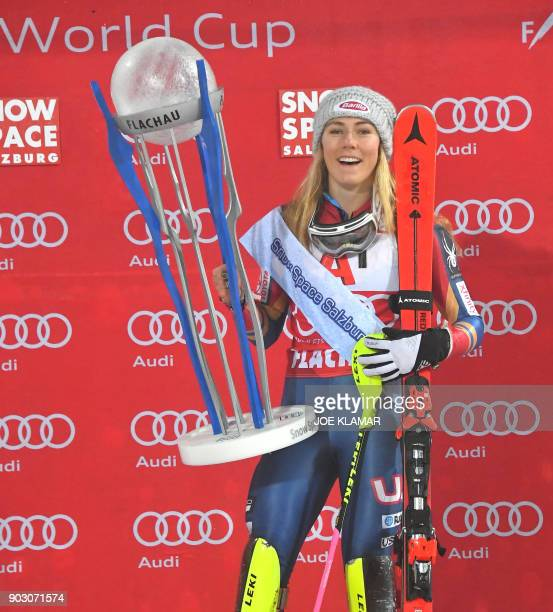 Mikaela Shiffrin of USA celebrates with the trophy winning the FIS World Cup Ladies night Slalom race in Flachau Austria on January 9 2018 / AFP...