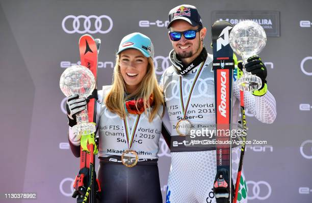 Mikaela Shiffrin of USA Dominik Paris of Italy take 1st place in the overall standings during the Audi FIS Alpine Ski World Cup Men's and Women's...