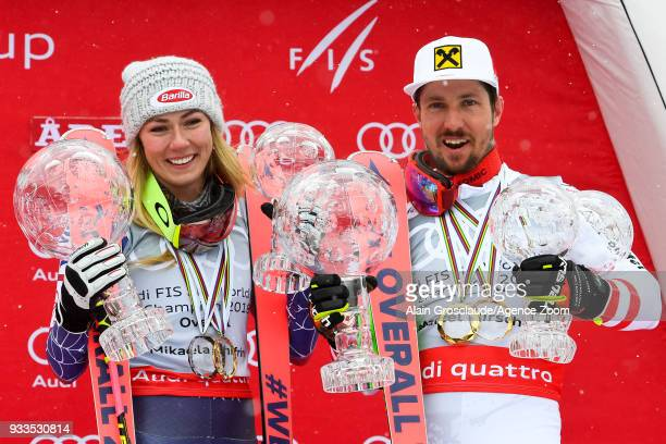Mikaela Shiffrin of USA wins the globe in the overall standings Marcel Hirscher of Austria wins the globe in the overall standings during the Audi...