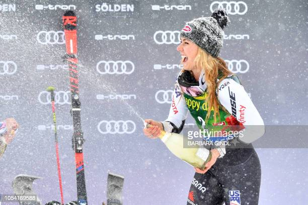 Mikaela Shiffrin sprays champagne on the podium as she celebrates after the second run of the Women's giant slalom at the FIS ski World cup on...