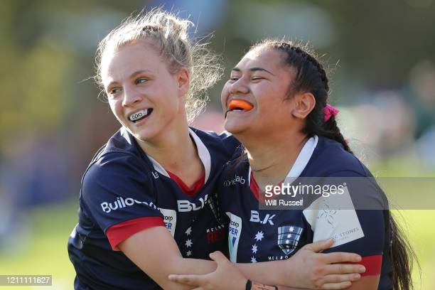 Mikaela Welti of the Rebels celebrates after scoring a try with team mate Jessica Rastrick of the Rebels during the round four SuperW Rugby match...