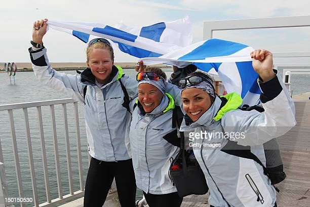 Mikaela Wulff Silja Kanerva and Silja Lehtinen of Finland celebrate finishing third and winning the bronze medal after competing in the Women's...