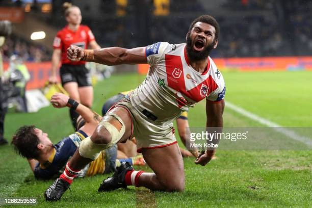 Mikaele Ravalawa of the Dragons celebrates scoring a try during the round 14 NRL match between the Parramatta Eels and the St George Illawarra...