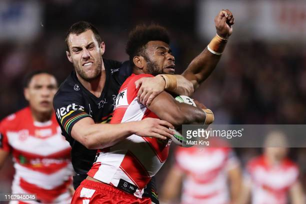 Mikaele Ravalawa of the Dragons is tackled by Isaah Yeo of the Panthers during the round 18 NRL match between the Penrith Panthers and the St George...