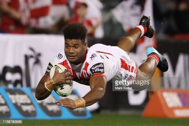 Mikaele Ravalawa of the Dragons scores a try during the round 15 NRL match between the St George Illawarra Dragons and the North Queensland Cowboys...