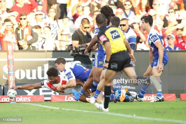 Mikaele Ravalawa of the Dragons scores a try during the round five NRL match between the St George Illawarra Dragons and the Canterbury Bulldogs at...
