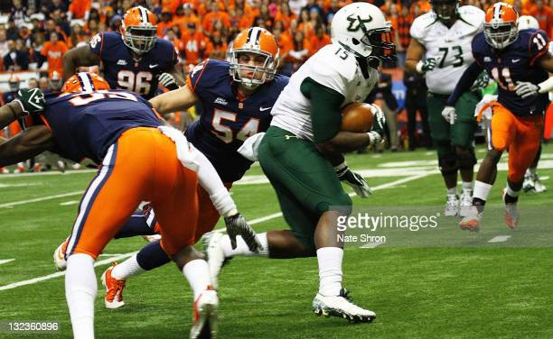 Mikail Marinovich of the Syracuse Orange reaches to tackle Victor Marc of the South Florida Bulls during the game at the Carrier Dome on November 11...