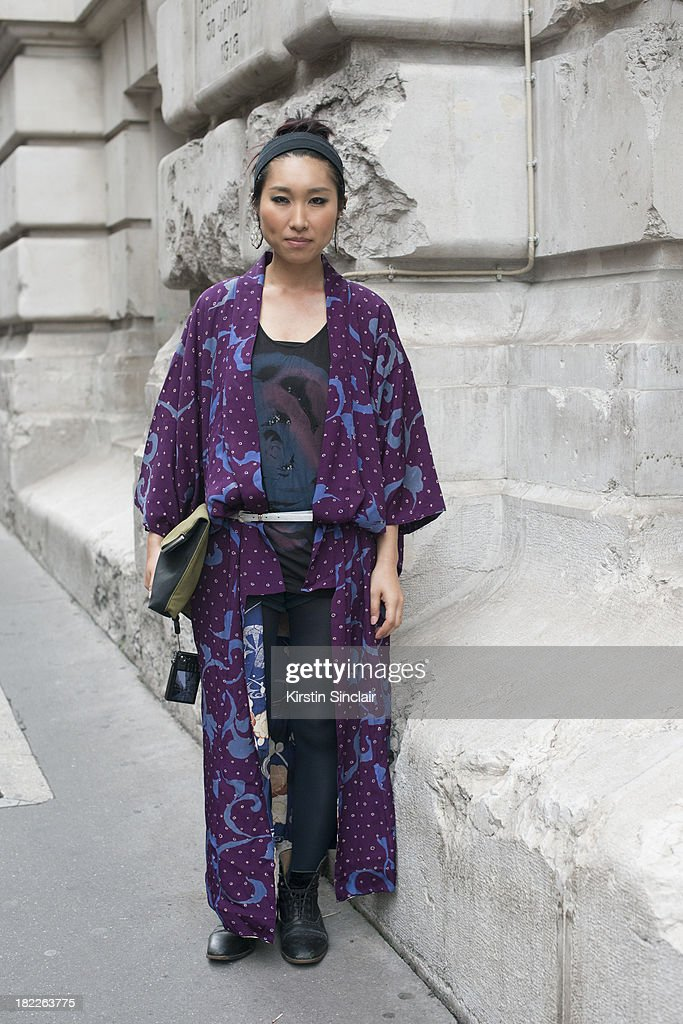Mikako wears a vintage Kimono, H and M bag, vintage boots and Diesel T shirt on day 5 of Paris Fashion Week Spring/Summer 2014, Paris September 28, 2013 in Paris, France.