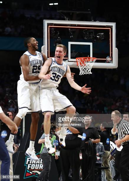 Mikal Bridges and Matt Kennedy of the Villanova Wildcats celebrate after defeating the Michigan Wolverines during the 2018 NCAA Men's Final Four...