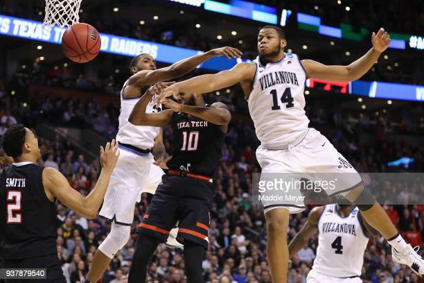 Mikal Bridges and Omari Spellman of the Villanova Wildcats knock the ball away from Niem Stevenson of the Texas Tech Red Raiders during the second...