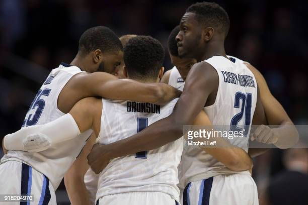 Mikal Bridges Jalen Brunson Omari Spellman and Dhamir CosbyRoundtree of the Villanova Wildcats huddle prior to the game against the St John's Red...