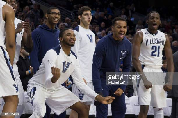 Mikal Bridges Jermaine Samuels Dylan Painter Phil Booth and Dhamir CosbyRoundtree of the Villanova Wildcats celebrate from the bench after a made...