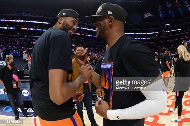 Mikal Bridges of the Phoenix Suns and Chris Paul of the Phoenix Suns celebrate after the game against the LA Clippers during Game 6 of the Western...