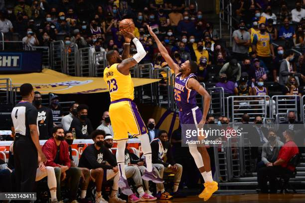Mikal Bridges of the Phoenix Suns attempts to block a shot by LeBron James of the Los Angeles Lakers during Round 1, Game 3 of the 2021 NBA Playoffs...