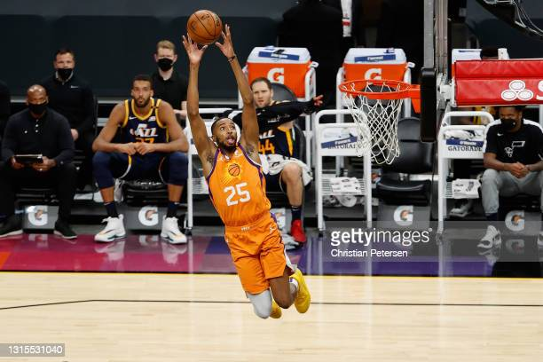 Mikal Bridges of the Phoenix Suns goes up for a slam dunk against the Utah Jazz during the first half of the NBA game at Phoenix Suns Arena on April...