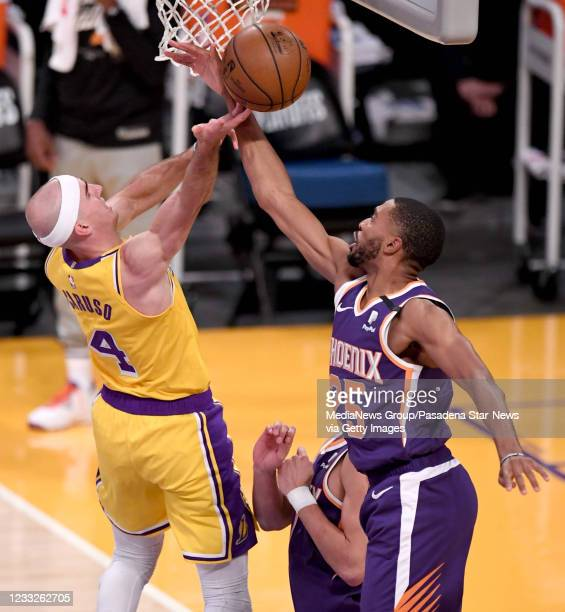 Mikal Bridges of the Phoenix Suns knocks the ball away from Alex Caruso of the Los Angeles Lakers in the first half of game six of the Western...