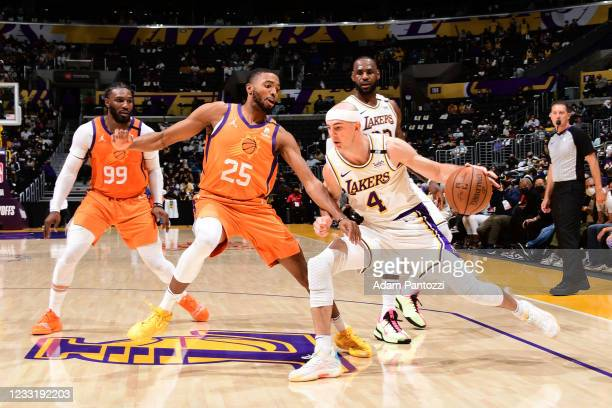 Mikal Bridges of the Phoenix Suns plays defense on Alex Caruso of the Los Angeles Lakers during Round 1, Game 4 of the 2021 NBA Playoffs on May 30,...