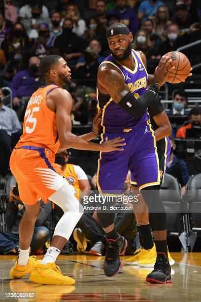 Mikal Bridges of the Phoenix Suns plays defense on LeBron James of the Los Angeles Lakers on October 22, 2021 at STAPLES Center in Los Angeles,...