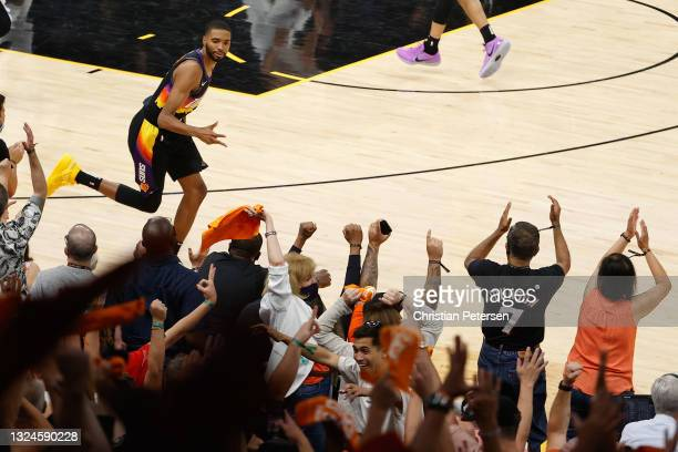 Mikal Bridges of the Phoenix Suns reacts to a three-point shot against the LA Clippers during the second half of game one of the Western Conference...