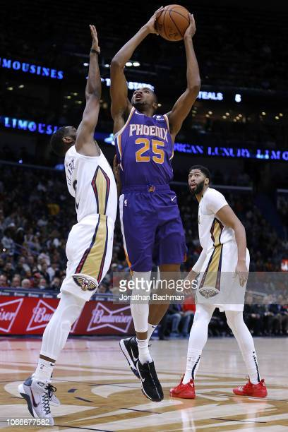 Mikal Bridges of the Phoenix Suns shoots against Ian Clark of the New Orleans Pelicans during the second half at the Smoothie King Center on November...