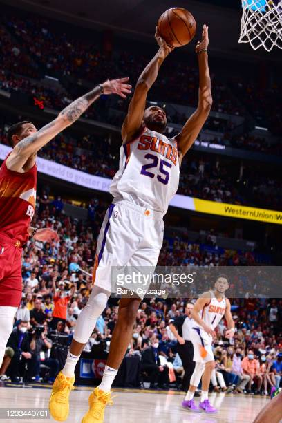 Mikal Bridges of the Phoenix Suns shoots the ball against the Denver Nuggets during Round 2, Game 4 of the 2021 NBA Playoffs on June 13, 2021 at the...