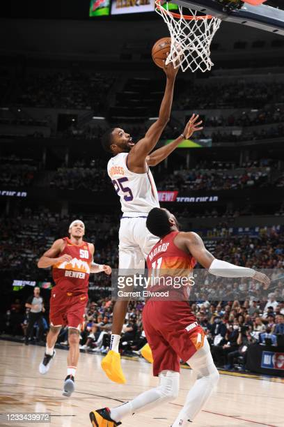 Mikal Bridges of the Phoenix Suns shoots the ball during the game against the Denver Nuggets during Round 2, Game 4 of the 2021 NBA Playoffs on June...