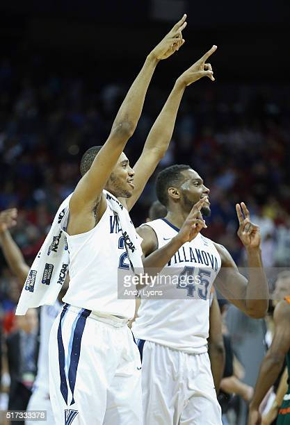 Mikal Bridges of the Villanova Wildcats and Darryl Reynolds celebrate defeating the Miami Hurricanes 9269 during the 2016 NCAA Men's Basketball...