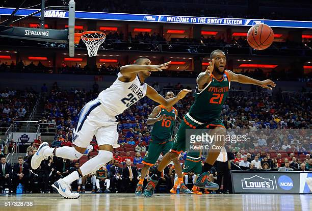 Mikal Bridges of the Villanova Wildcats and Kamari Murphy of the Miami Hurricanes chase the ball in the first half of their game during the 2016 NCAA...