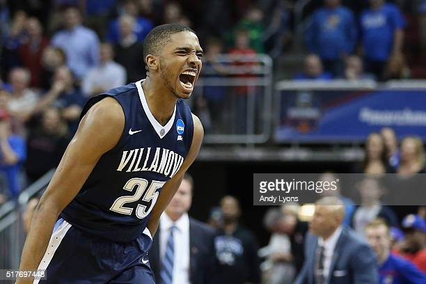 Mikal Bridges of the Villanova Wildcats celebrates defeating the Kansas Jayhawks 6459 during the 2016 NCAA Men's Basketball Tournament South Regional...
