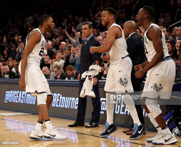 Mikal Bridges of the Villanova Wildcats celebrates his three point shot with the bench during overtime period against the Providence Friars in the...
