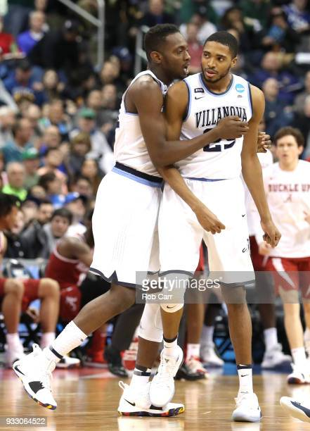 Mikal Bridges of the Villanova Wildcats celebrates with his teammate Dhamir CosbyRoundtree after a basket against the Alabama Crimson Tide during the...